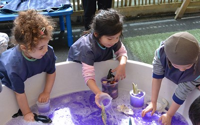 girls water play at daycare
